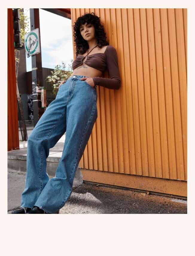 Model wearing Garage jeans.
