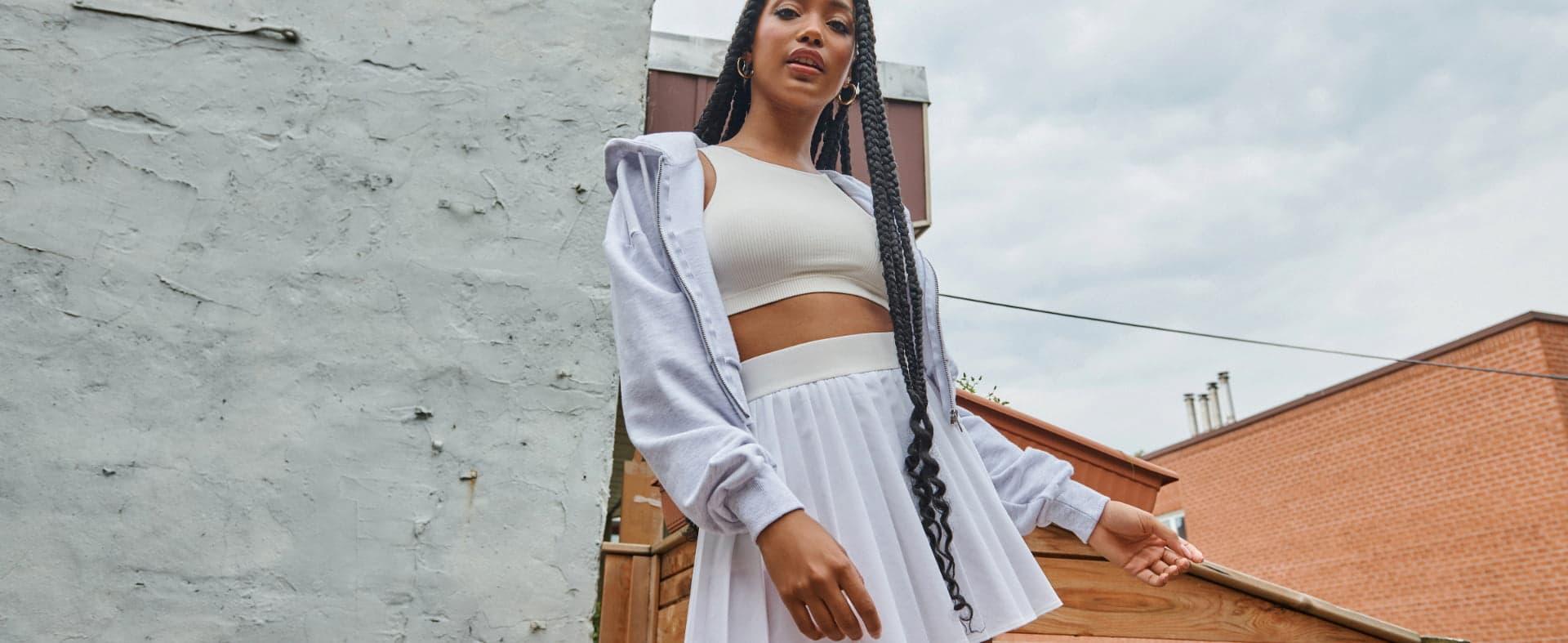 Model wearing Garage clothing.
