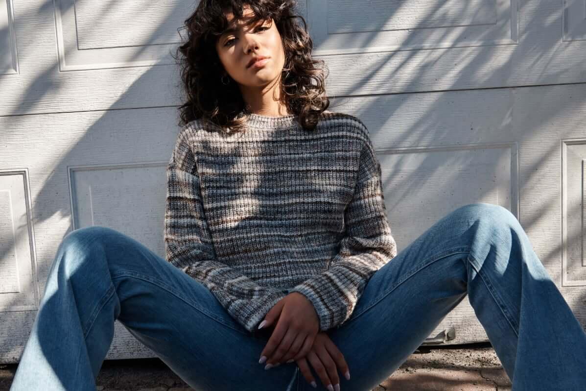 Model wearing a Garage sweater.
