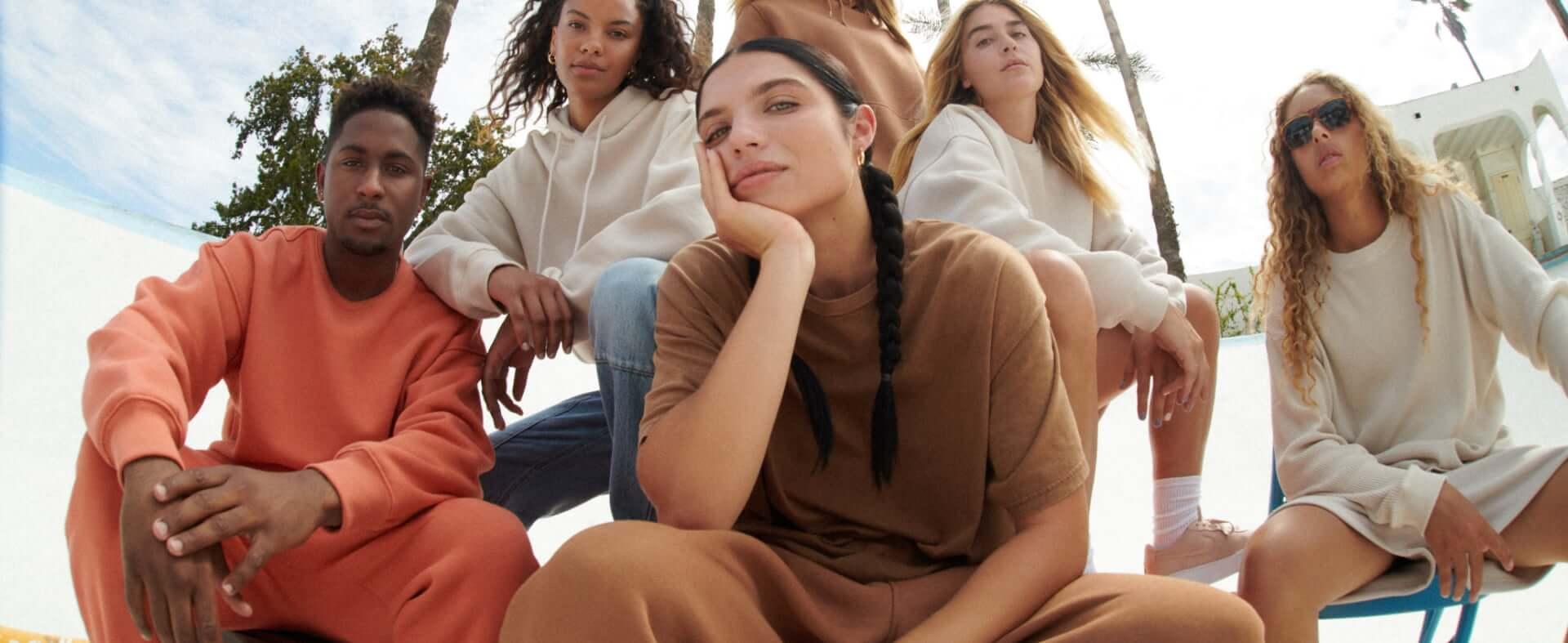 Models are wearing Garage unisex clothing.